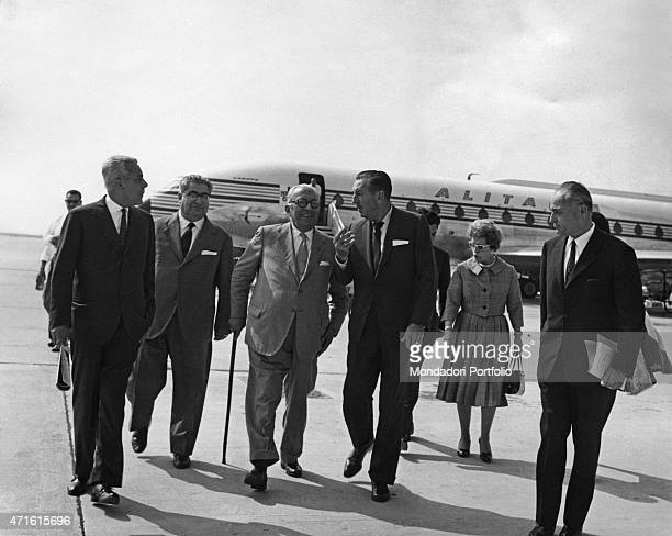 American cartoonist animator and tycoon Walt Disney and his wife Lillian Bounds being welcomed at the airport by Italian publisher Arnoldo Mondadori...