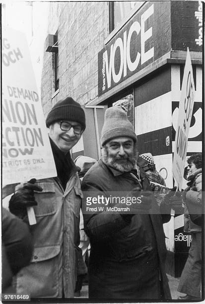 American cartoonist Jules Feiffer and journalist and music critic Nat Hentoff demonstrate outside the offices of the Village Voice during a union...