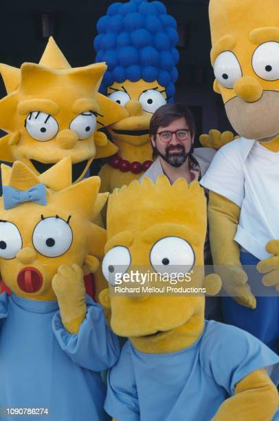 American Cartoonist Matt Groening poses with characters from his animated TV series The Simpsons November 1990