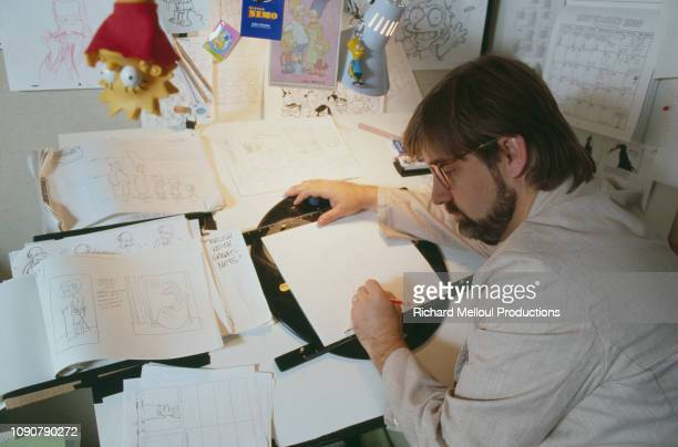 American Cartoonist Matt Groening poses with characters from his animated TV series 'The Simpsons' November 1990