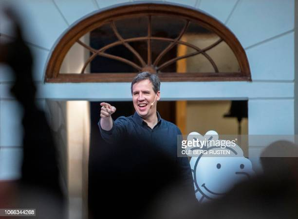 American cartoonist producer and author of children's books Jeff Kinney talks to children during a visit in Oslo Norway on November 29 2018 / Norway...