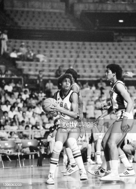American Cheryl Miller dribbles the ball and looks toward teammate Lynette Woodard in a basketball game against the Cuban team in the 1983...