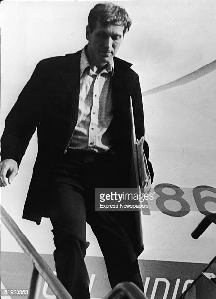 American chess champion and prodigy the controversial and tempermental Bobby Fischer exits an airplane as he arrives to participate in a world...