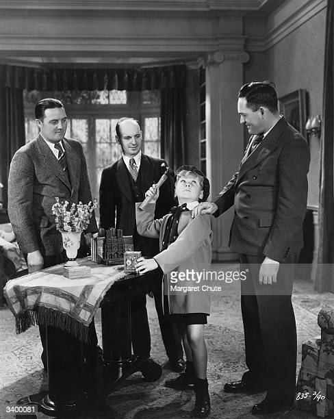 American child actor Jackie Cooper shows off his skills with a hammer in a scene from the film 'Skippy' directed by Norman Taurog for Paramount