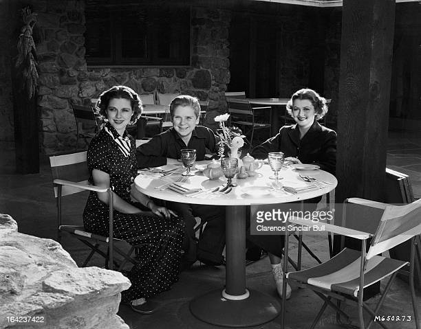 American child actor Jackie Cooper with two women 16th January 1936