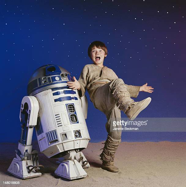American child actor Jake Lloyd clowns about with R2D2 his robot costar from 'Star Wars Episode I The Phantom Menace' Los Angeles California 1999