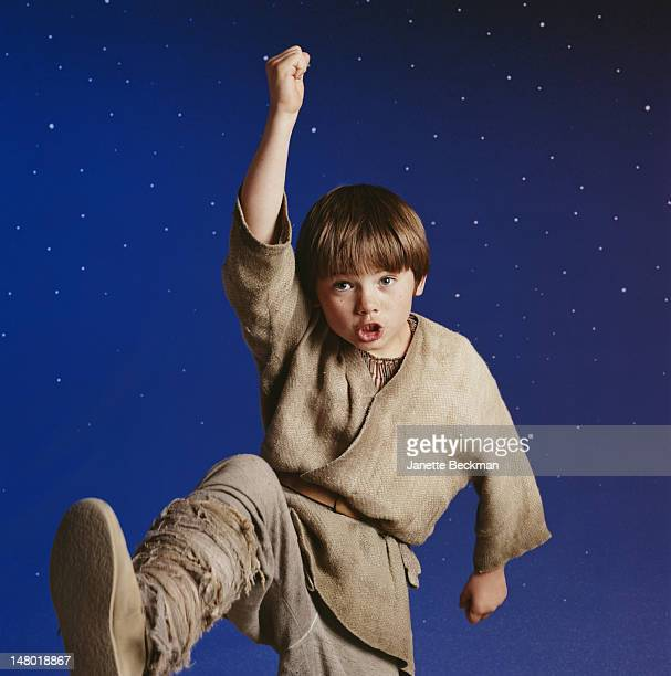 American child actor Jake Lloyd clowns during a photoshot to promote his film 'Star Wars Episode I The Phantom Menace' Los Angeles California 1999