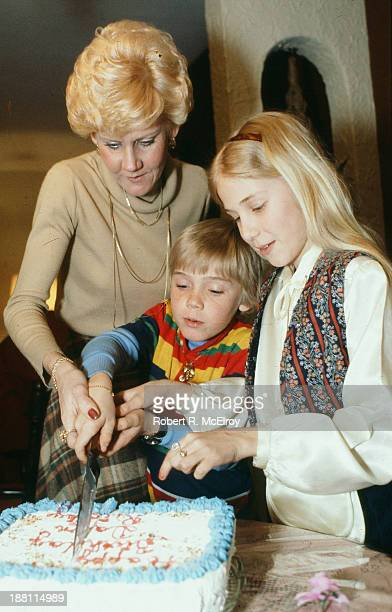 American child actor Ricky Schroder cuts the cake at his ninth birthday party April 13 1979 His sister fellow actor Dawn Schroder is beside him