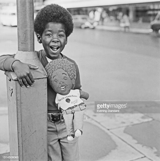 American child actor Rodney Allen Rippy holds a rag doll of himself wearing a t-shirt with the slogan 'Take Life a Little Easier', UK, 10th May 1974....