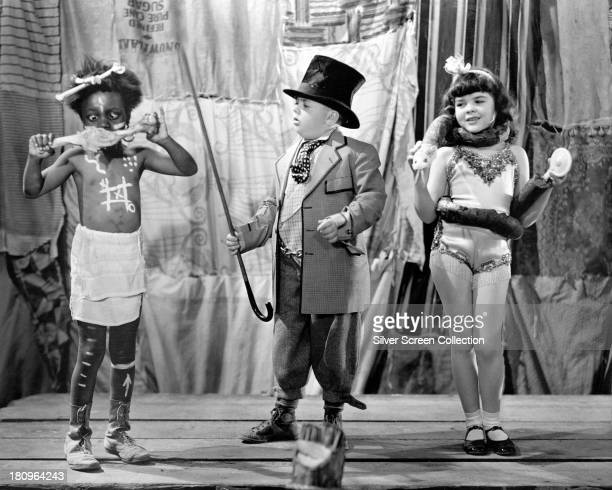 American child actors Billie 'Buckwheat' Thomas George 'Spanky' McFarland and Darla Hood in a promotional still for 'Clown Princes' a film in the the...