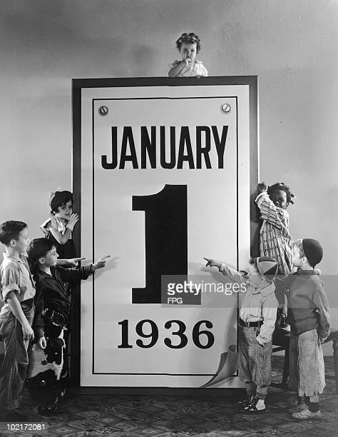 American child actors of the Hal Roach 'Our Gang' and 'Little Rascals' comedy films with an outsize calendar for 1st January 1936