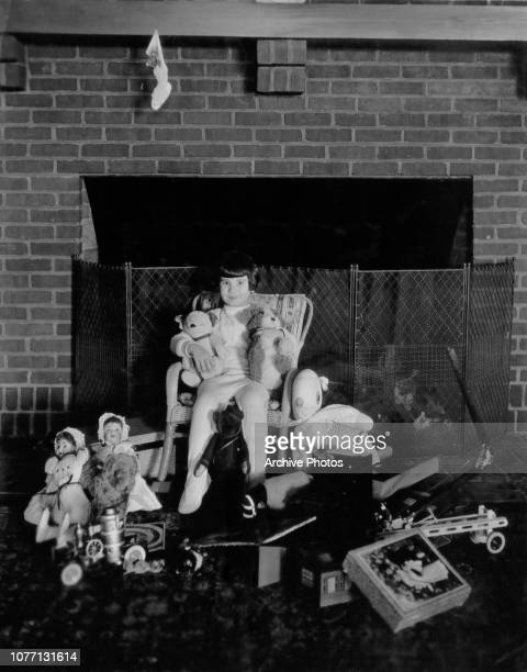 American child actress Baby Peggy later known as Diana Serra Cary surrounded by toys at Christmas circa 1923