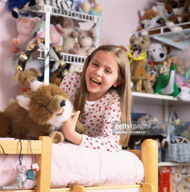 American child actress Mae Whitman surrounded by her toys, circa 1996.
