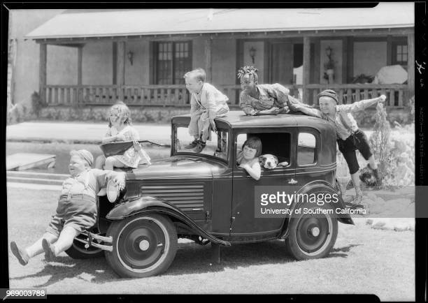 American child actress Mary Ann Jackson in a miniature car with Pete the Pup and with fellow child actors from the 'Our Gang' comedy short film...