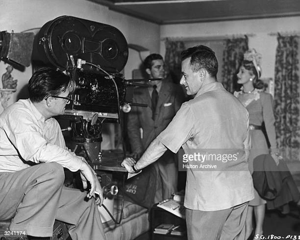 American cinematographer Gregg Toland and Frenchborn director William Wyler talk on the set of Wyler's film 'The Best Years of Our Lives' American...