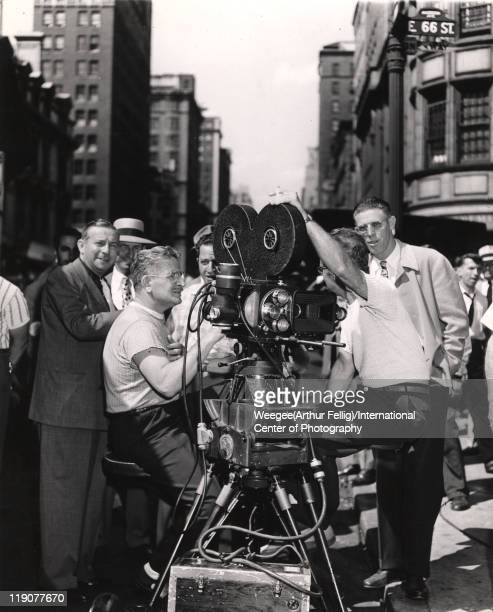 American cinematographer William H Daniels sits behind the camera the filming the movie 'The Naked City' New York New York mid to late 1940s The film...