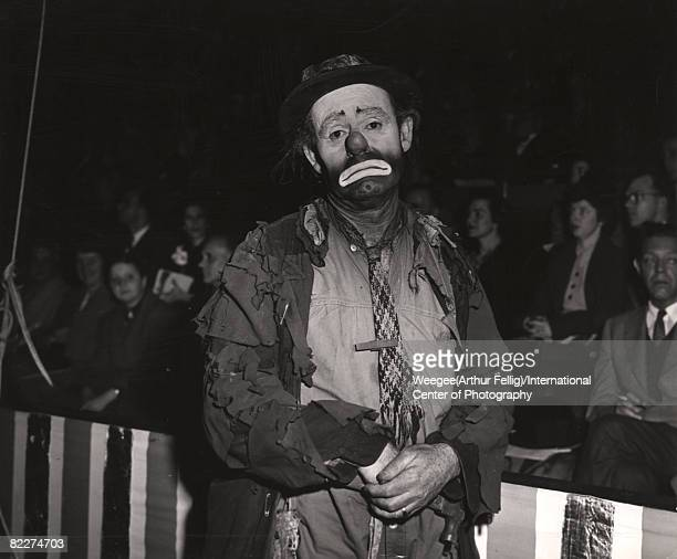 American circus performer and sometime film actor Emmett Kelly in costume as his clown creation Weary Willy poses during a performance at Madison...