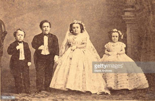 American circus performer Charles Sherwood Stratton aka 'General Tom Thumb' poses with his new bride Mercy Lavinia Warren Bump and their wedding...