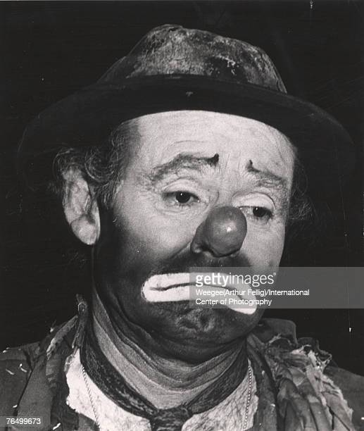 American circus performer Emmett Kelly in costume and makeup as his famous clown character 'Weary Willy' early 1940s Photo by Weegee/International...