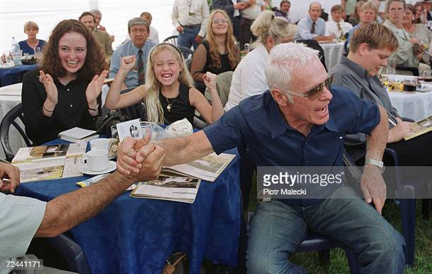 American citizen Jim Ferlita right and his friends celebrate after having just made a good deal on a horse at the annual world famous horse auction...