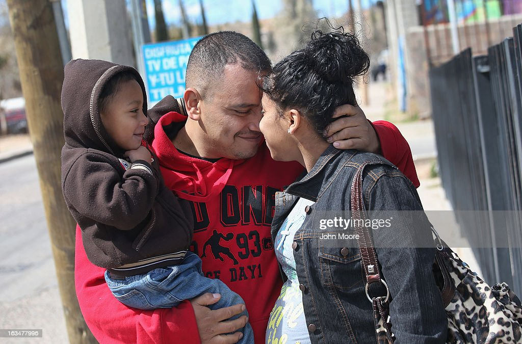American citizen Lace Rodriguez and her husband Javier Guerrero from Mexico, embrace with their son Javier Jr. (3), on March 10, 2013 in Nogales, Mexico. The family lived together in Phoenix before Guerrero, an undocumented worker from Mexico, was detained by the Border Patrol after being stopped for speeding and drug possession, held for three months by ICE and then deported March 4 to Nogales, Mexico. Guerrero had lived in the United States for 17 years. He and Rodriguez, a medical student, have two children, and she is nine-month's pregnant with a third. The splitting up of families has become a major issue as the U.S. works towards immigration reform.