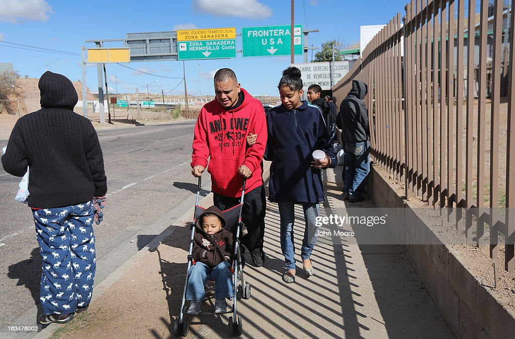 American citizen Lace Rodriguez and her husband Javier Guerrero from Mexico, walk with their son Javier Jr. (3), on March 10, 2013 in Nogales, Mexico. The family lived together in Phoenix before Guerrero, an undocumented worker from Mexico, was detained by the Border Patrol after being stopped for speeding and drug possession, held for three months by ICE and then deported March 4 to Nogales, Mexico. Guerrero had lived in the United States for 17 years. He and Rodriguez, a medical student, have two children, and she is nine-month's pregnant with a third. The splitting up of families has become a major issue as the U.S. works towards immigration reform.