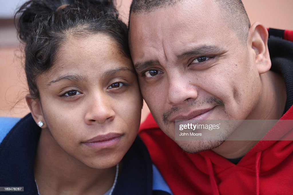 American citizen Lace Rodriguez and her husband Javier Guerrero from Mexico, embrace near the U.S.-Mexico border on March 10, 2013 in Nogales, Mexico. The family lived together in Phoenix before Guerrero, an undocumented worker from Mexico, said he was detained by the U.S. Border Patrol after being stopped for speeding and drug possession, held for three months by ICE and then deported March 4 to Nogales, Mexico. Guerrero had lived in the United States for 17 years. He and Rodriguez, a medical student, have two children, and she is nine-month's pregnant with a third. The splitting up of families has become a major issue as the U.S. works towards immigration reform.