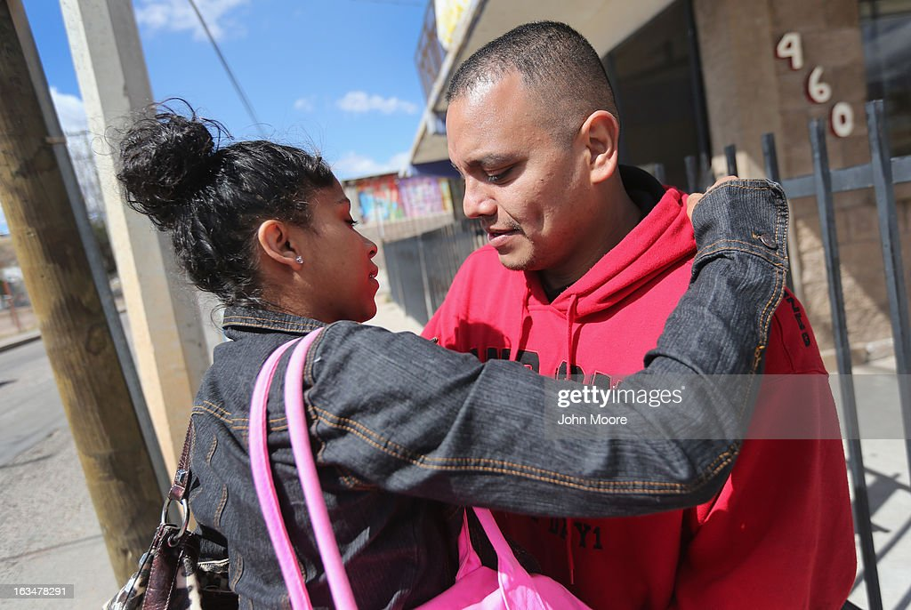 American citizen Lace Rodriguez and her husband Javier Guerrero from Mexico, embrace near the U.S._Mexico border on March 10, 2013 in Nogales, Mexico. The family lived together in Phoenix before Guerrero, an undocumented worker from Mexico, was detained by the Border Patrol after being stopped for speeding and drug possession,, held for three months by ICE and then deported March 4 to Nogales, Mexico. Guerrero had lived in the United States for 17 years. He and Rodriguez, a medical student, have two children, and she is nine-month's pregnant with a third. The splitting up of families has become a major issue as the U.S. works towards immigration reform.