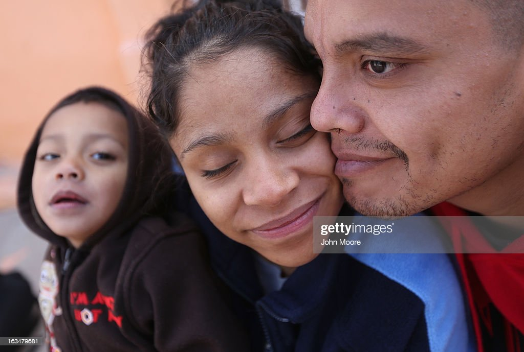 American citizen Lace Rodriguez and her husband Javier Guerrero from Mexico, embrace with their son Javier Jr. (3), on March 10, 2013 in Nogales, Mexico. The family lived together in Phoenix before Guerrero, an undocumented worker from Mexico, said he was detained by the U.S. Border Patrol after being stopped for speeding and drug possession, held for three months by ICE and then deported March 4 to Nogales, Mexico. Guerrero had lived in the United States for 17 years. He and Rodriguez, a medical student, have two children, and she is nine-months pregnant with a third. The splitting up of families has become a major issue as the U.S. works towards immigration reform.