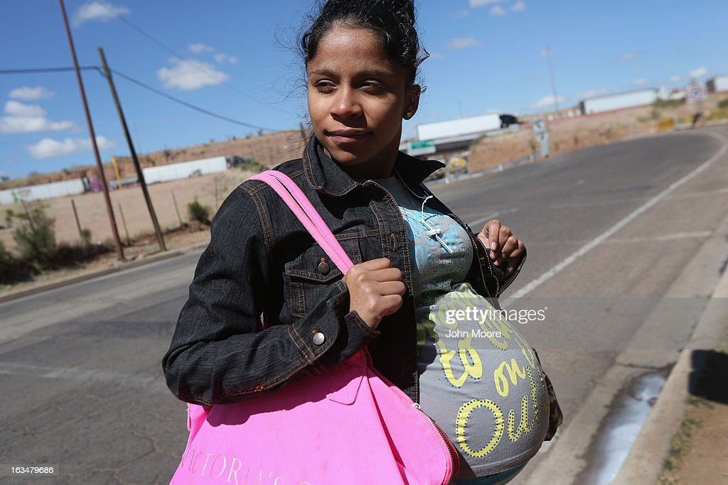 American citizen Lace Rodriguez looks back into Mexico while walking to the U.S. border after visiting her husband Javier Guerrero on March 10, 2013 in Nogales, Mexico. The family lived together in Phoenix before Guerrero, an undocumented worker from Mexico, said he was detained by the U.S. Border Patrol after being stopped for speeding and drug possession, held for three months by ICE and then deported March 4 to Nogales, Mexico. Guerrero had lived in the United States for 17 years. He and Rodriguez, a medical student, have two children, and she is nine-months pregnant with a third. The splitting up of families has become a major issue as the U.S. works towards immigration reform.
