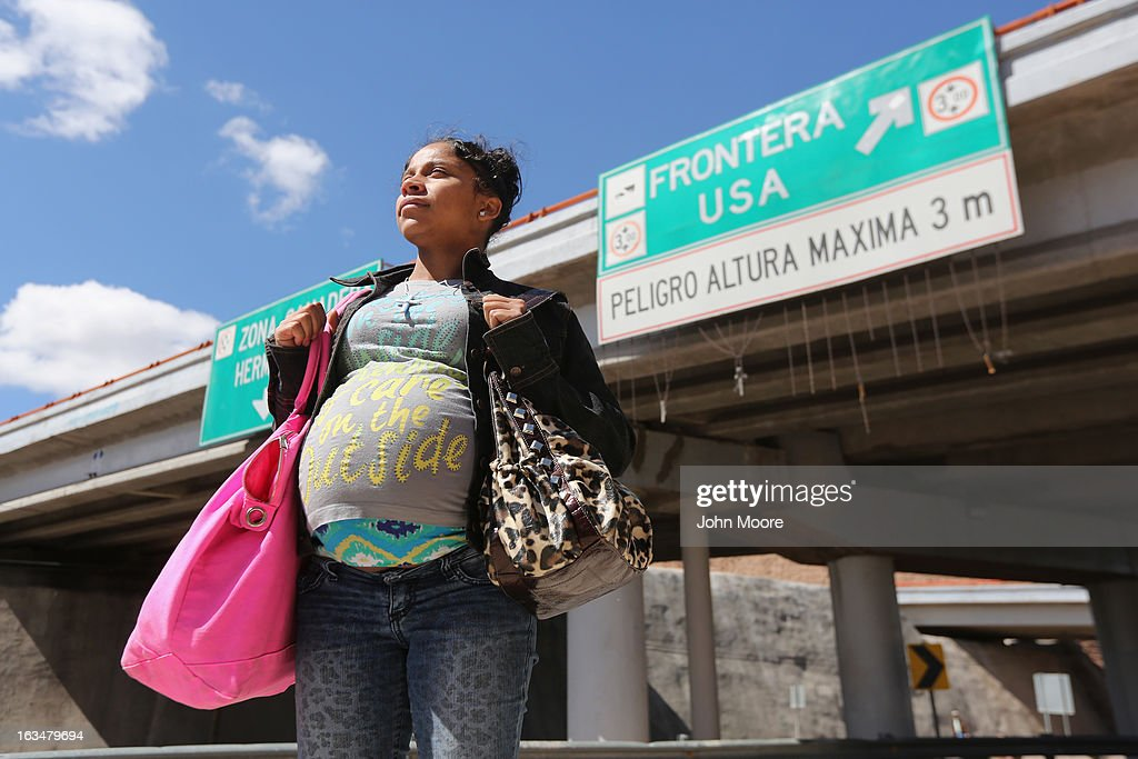 American citizen Lace Rodriguez looks back into Mexico while walking back to the U.S. border after visiting her husband Javier Guerrero on March 10, 2013 in Nogales, Mexico. The family lived together in Phoenix before Guerrero, an undocumented worker from Mexico, said he was detained by the U.S. Border Patrol after being stopped for speeding and drug possession, held for three months by ICE and then deported March 4 to Nogales, Mexico. Guerrero had lived in the United States for 17 years. He and Rodriguez, a medical student, have two children, and she is nine-months pregnant with a third. The splitting up of families has become a major issue as the U.S. works towards immigration reform.