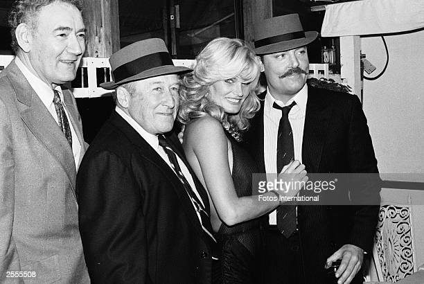 American city councilman John Ferraro author Mickey Spillane and actors Randi Brooks and Stacy Keach pose together as they celebrate 'Mickey Spillane...