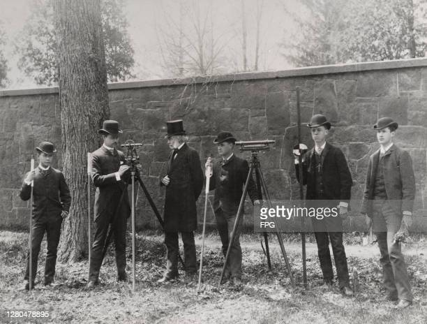 American civil engineer William A Norton , of the Sheffield Scientific School at Yale University, stands between two theodolites as he leads students...