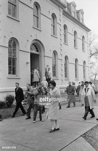 Photographers and reporters follow around Charlayne Hunter as she walks to class at University of Georgia The negro girl under court order to be re...