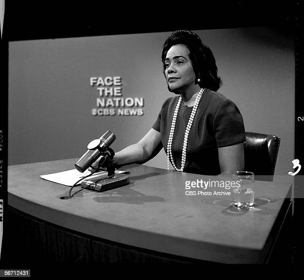 American civil rights activist and widow of Dr Martin Luther King Jr Coretta Scott King sits behind a microphone at a desk on the set of the CBS news...