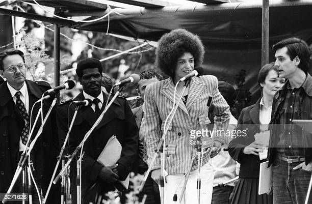 American civil rights activist Angela Davis making an address at the 19th Evangelical Church Day at Hamburg West Germany Disarmament is a central...