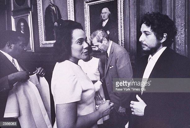 American civil rights activist Coretta Scott King, widow of civil rights leader Martin Luther King Jr., talks to American singer and songwriter Bob...