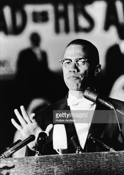 American civil rights activist Malcolm X speaks at a podium during a Black Muslim rally in Washington DC circa 1963
