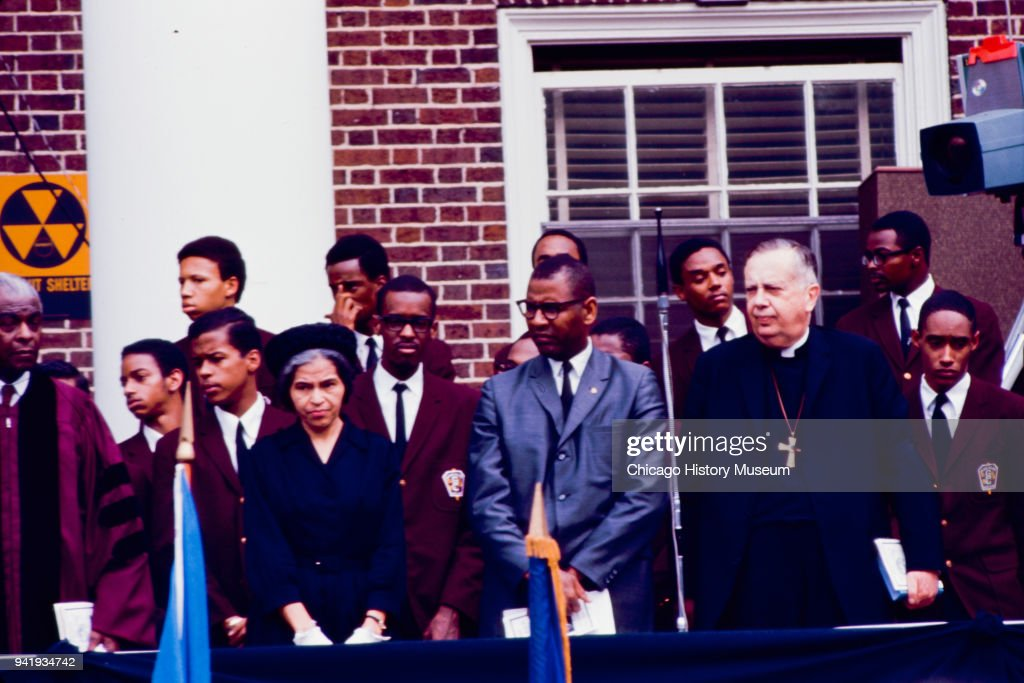 American Civil Rights activist Rosa Parks (1913 - 2005) (center left), among other mourners and students, stand during Dr Martin Luther King Jr's public memorial service at Morehouse College, Atlanta, Georgia, April 9, 1968.