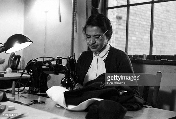 American Civil Rights activist Rosa Parks at work as a seamstress, shortly after the beginning of the Montgomery bus boycott, Montgomery, Alabama,...