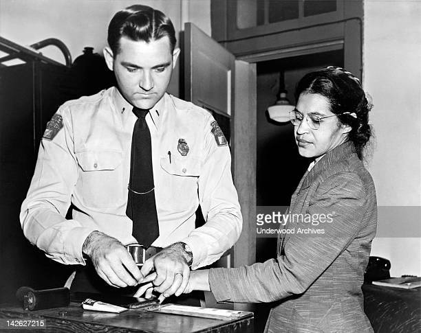 American civil rights activist, Rosa Parks , being fingerprinted after her refusal to move to the back of a bus to accommodate a white passenger...