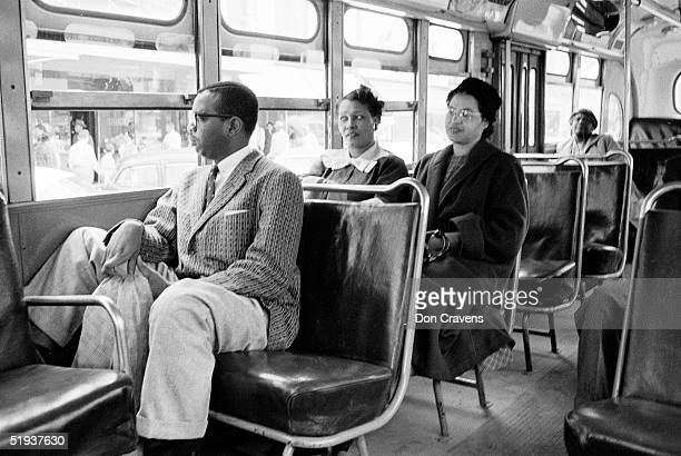 American Civil Rights activist Rosa Parks rides a bus at the end of the Montgomery bus boycott Montgomery Alabama December 26 1956