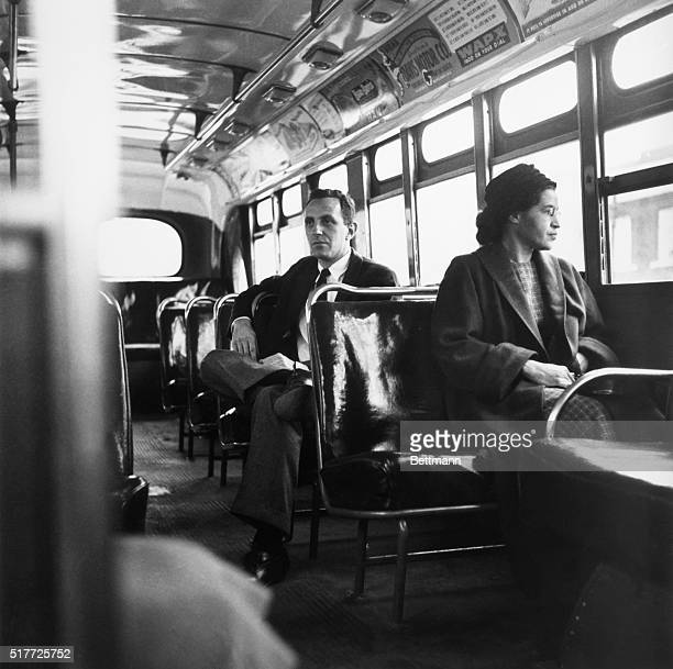 American civil rights activist, Rosa Parks sits in the front of a bus in Montgomery, Alabama, after the Supreme Court ruled segregation illegal on...