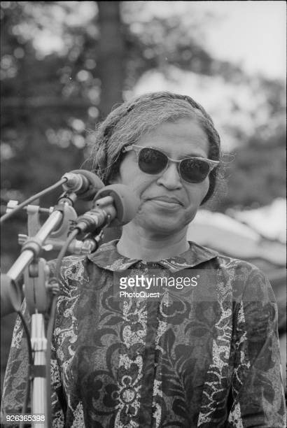 American Civil Rights activist Rosa Parks speaks at a microphone during the Poor People's March on Washington, Washington DC, June 20, 1968. The...