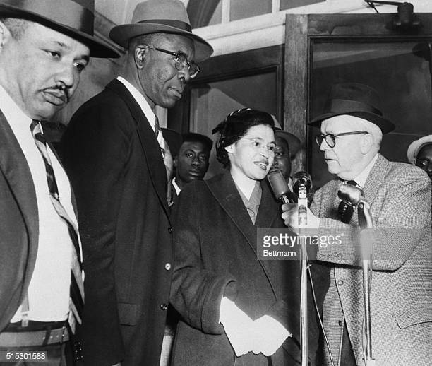 American civil rights activist, Rosa Parks, speaks with an interviewer as she arrives at court with Reverend Edward Nixon and 91 other...