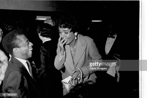 American Civil Rights activists author James Baldwin and actress & singer Lena Horne share a laugh at an unspecified event, New York, 1965.