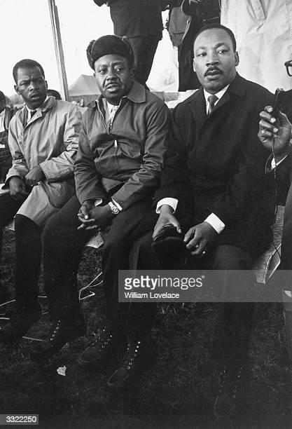 American civil rights activists John Lewis , Ralph Abernathy and Dr Martin Luther King at a civil rights march in Alabama, March 1965.
