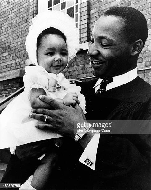 American Civil Rights and religious leader Dr Martin Luther King Jr holds his infant daughter Yolanda King in his arms 1956