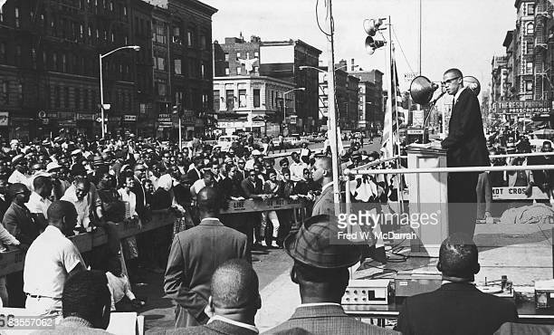American Civil Rights and religious leader Malcolm X speaks to a crowd at a rally in Harlem New York New York September 7 1963