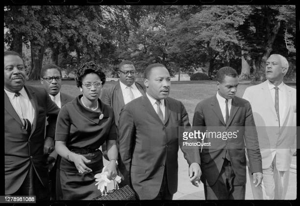 American Civil Rights and religious leader Reverend Martin Luther King Jr and others arrive at the White House for a meeting with President Lyndon B...